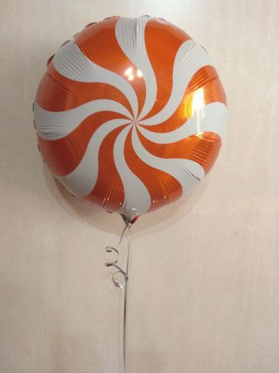 Леденец оранжевый шар фольгированный с гелием