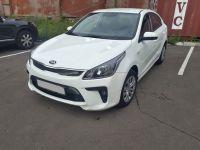 Прокат автомобиля kia rio 2017 года белого цвета