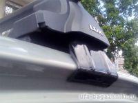 Универсальный багажник на крышу D-Lux 1, крыловидные дуги