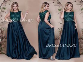 Зеленое вечернее платье с атласной юбкой