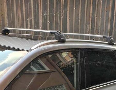 Багажник на крышу Suzuki SX4 II 2013-, Turtle Air 2, аэродинамические дуги на интегрированные рейлинги (серебристый цвет)