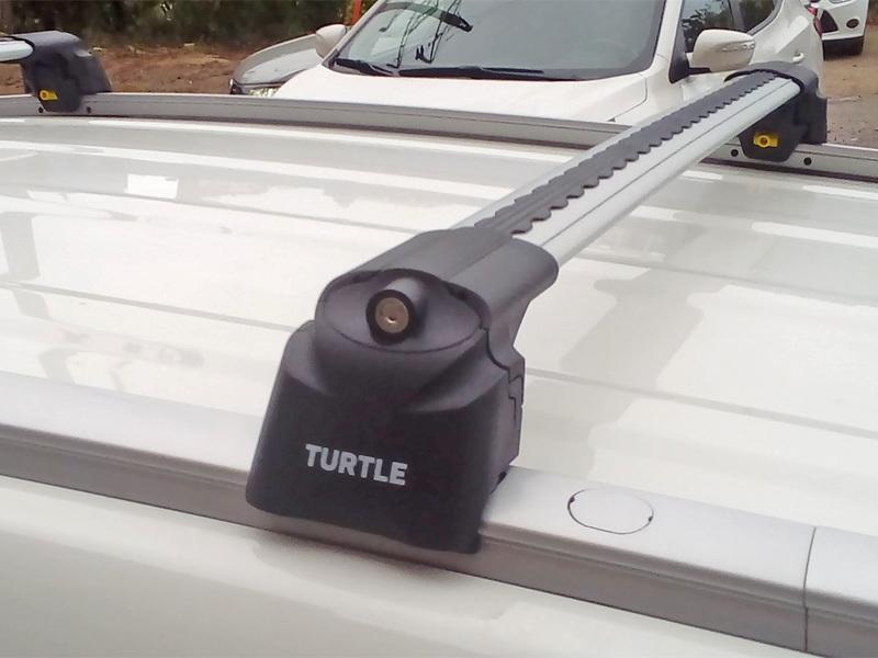Багажник на крышу Hyundai Tucson 2016-..., Turtle Air 2, аэродинамические дуги на интегрированные рейлинги (серебристый цвет)