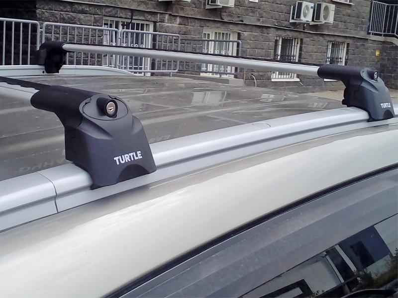 Багажник на крышу Kia Sportage 3, Turtle Air 2, аэродинамические дуги на интегрированные рейлинги (серебристый цвет)