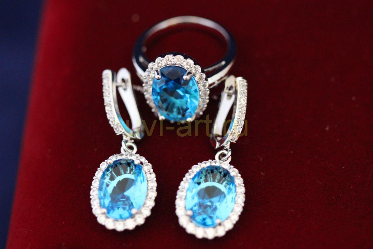 Комплект позолоченных ,белым золотом украшений с искусственными голубыми топазами - серьги и кольцо (арт. 800231)
