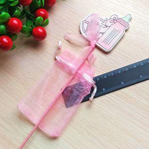 Бутылочка розов с мешочком на пике