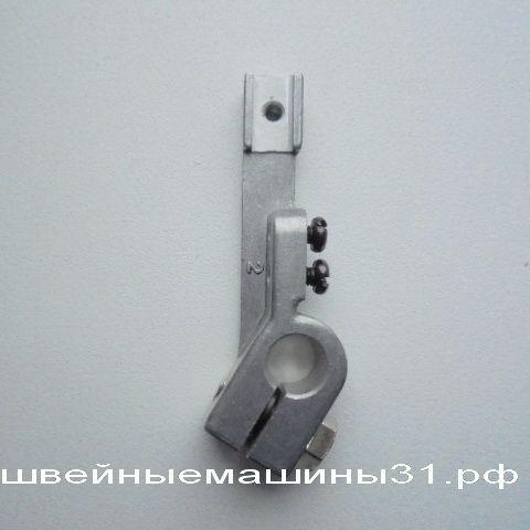 Крепление левого (нижнего) петлителя JUKI 644, magestic 54    цена 1600 руб.