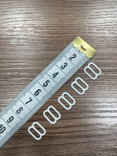 Пряжка регулятор белый 10 мм