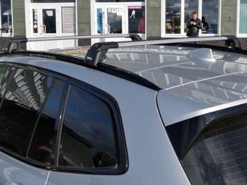Багажник на крышу BMW X1 F48 2015-..., Turtle Air 2, аэродинамические дуги на интегрированные рейлинги (серебристый цвет)