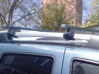 Багажник на крышу Renault Duster, Атлант, стальные прямоугольные дуги на рейлинги