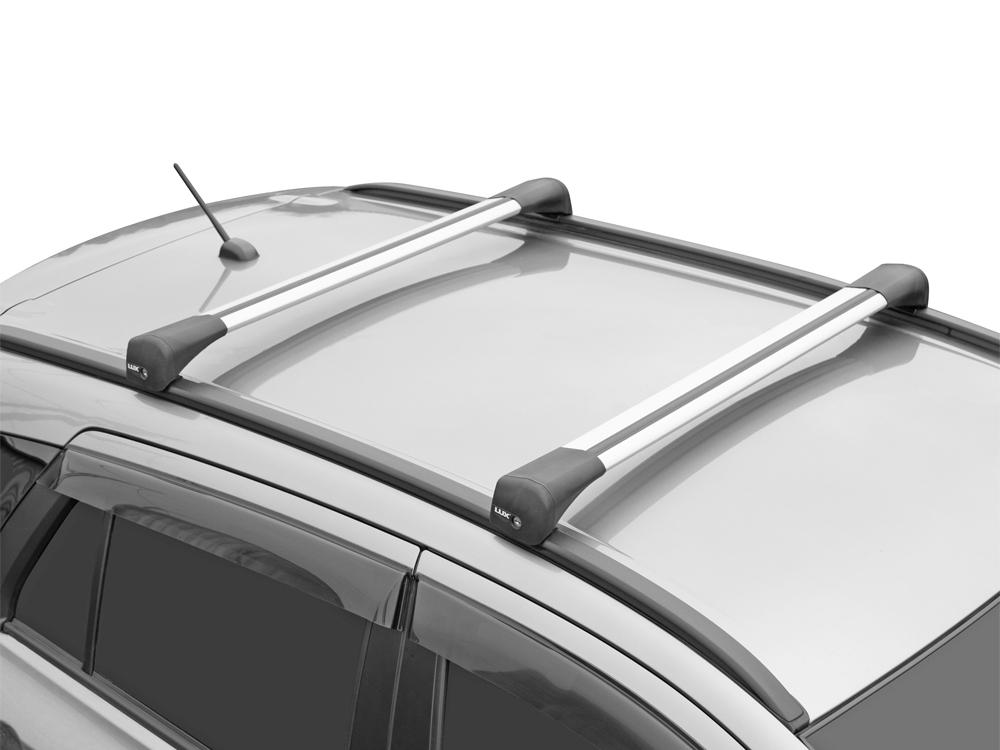 Багажник на интегрированные рейлинги Lada Vesta SW / SW Cross, Lux Bridge, крыловидные дуги (серебристый цвет)