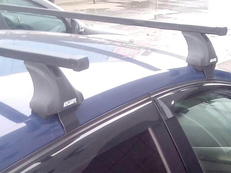 Багажник на крышу Hyundai Elantra 6 (AD) 2018-..., рестайлинг, Атлант, стальные прямоугольные дуги (в пластике)
