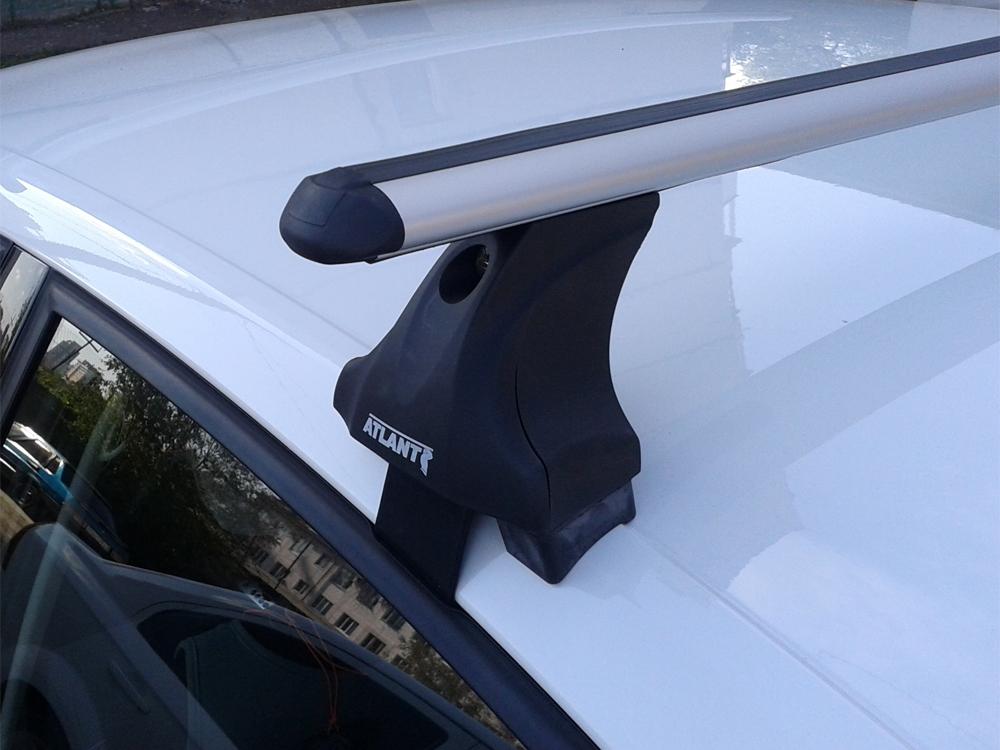 Багажник на крышу Volkswagen Passat B7, Атлант, аэродинамические дуги, опора Е