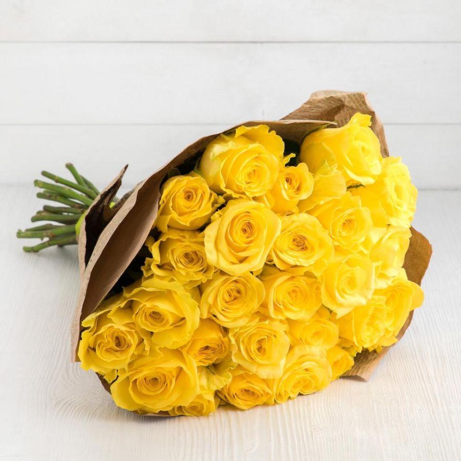 Акция! 25 желтых роз 60 см в крафт бумаге