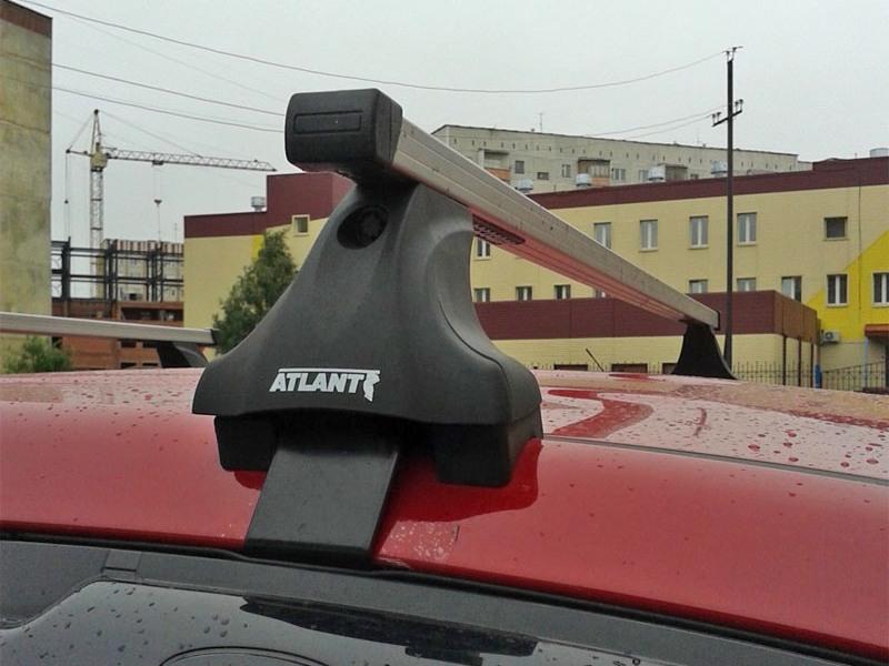 Багажник на крышу на Mitsubishi L200 2015-..., Атлант, прямоугольные дуги, опора Е