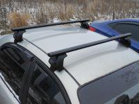 Багажник на крышу Kia Optima IV (2015-...), Евродеталь, аэродинамические дуги (черный цвет)