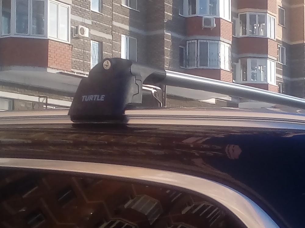 Багажник на крышу Volvo XC60 2017-..., Turtle Air 2, аэродинамические дуги на интегрированные рейлинги (серебристый цвет)