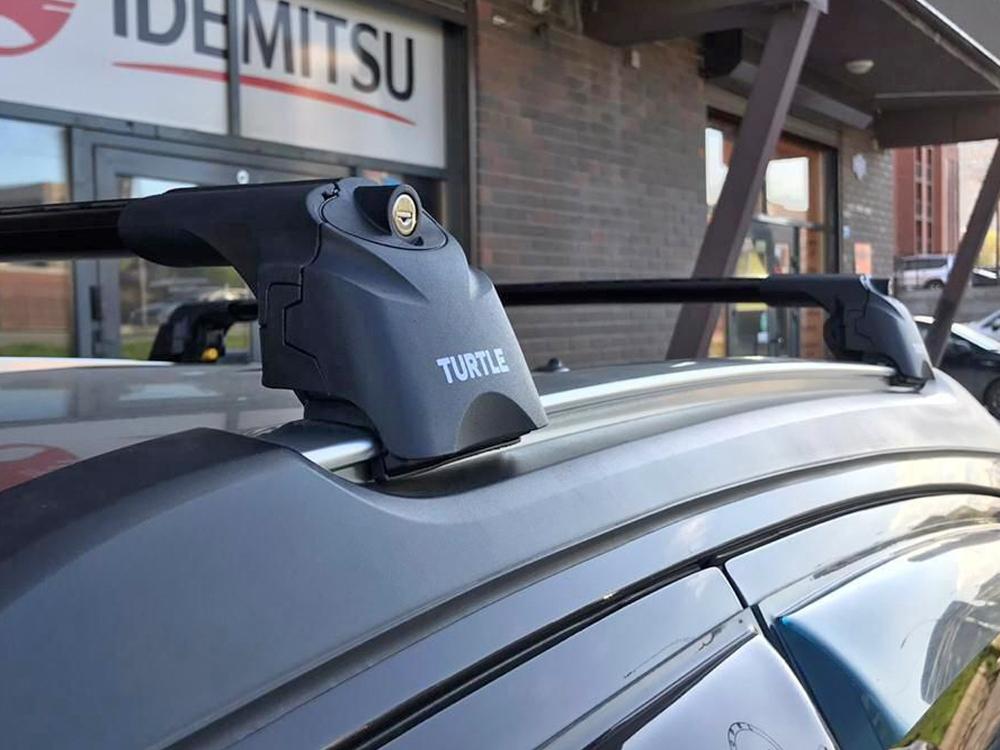 Багажник на крышу Opel Mokka, Turtle Air 2, аэродинамические дуги на интегрированные рейлинги (черный цвет)