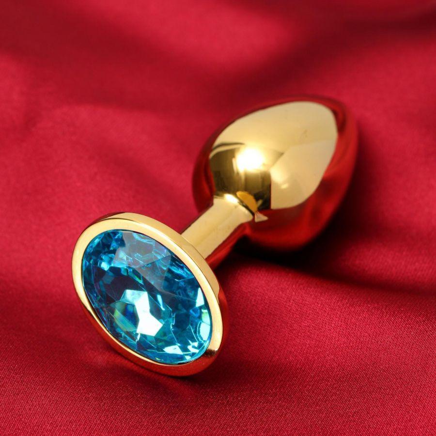 Анальная втулка, золотая,с голубым кристаллом, D = 27 мм