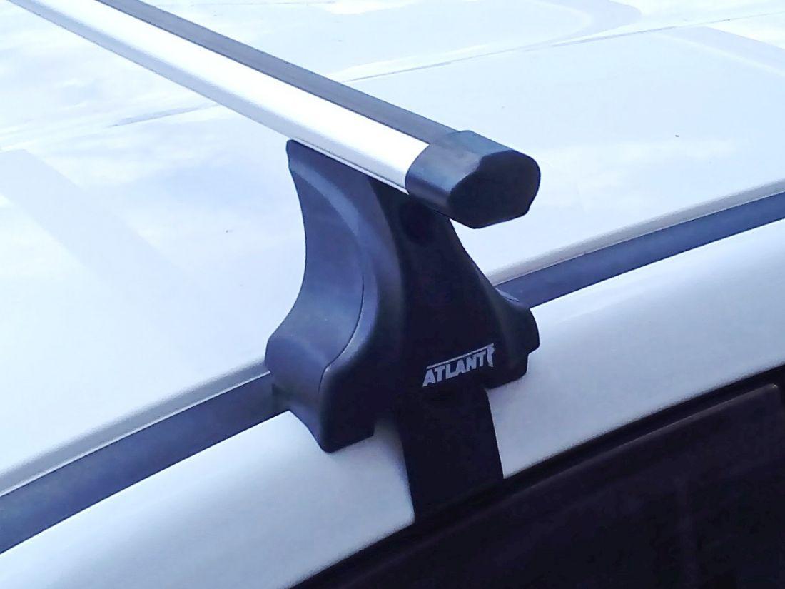 Багажник на крышу Renault Scenic 3, Атлант, аэродинамические дуги Эконом, опора Е