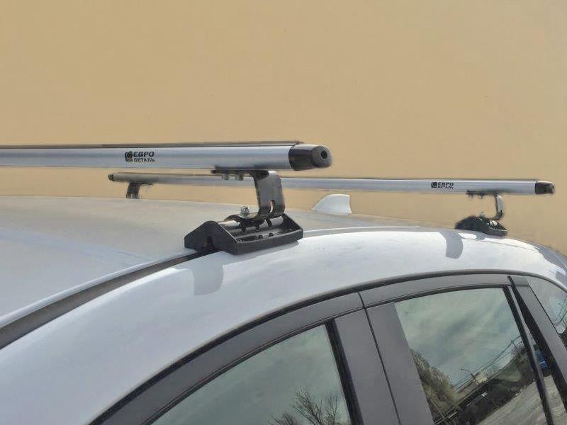 Универсальный багажник на крышу Peugeot Partner 2008-..., Евродеталь, вид Е, аэродинамические дуги