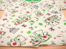 Ткань одежды белого цвета с различными цветными принтами. Состав 100% хлопок интерлок-пенье